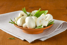 Fresh button mushrooms and culinary herbs Stock Images