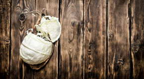 Fresh cabbage on a cutting Board. On wooden background Royalty Free Stock Images