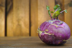 Fresh cabbage purple kohlrabi with green leaves. Cabbage purple kohlrabi with green leaves on wooden background Stock Photography