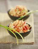 Fresh cabbage salad. In black bowls stock photography