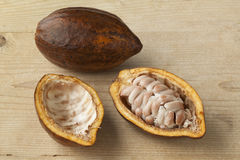 Fresh Cacao fruit. Whole and half fresh ripe cacao fruit and seeds Royalty Free Stock Photography