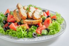 Fresh Caesar salad with tomatoes, cucumber and chicken royalty free stock photography