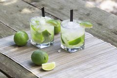 Fresh Caipirinha, Brazilian rum cocktail with lime royalty free stock photography