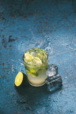 Fresh caipirinha cocktail with lime and ice. Stock Photo