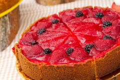 Fresh cake with berries. Fresh cake with a strawberry and blackberry Stock Image