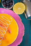 Fresh cake lemons and blueberries Stock Images