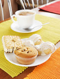 Fresh cakes and tea on the table Stock Images