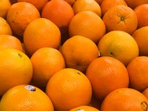 Fresh California Naval Oranges. For sale in a produce department of a grocery store stock photography