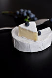 Fresh camembert cheese. French camembert cheese and fresh grape Stock Images