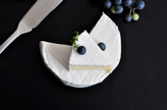 Fresh camembert cheese. French camembert cheese and fresh grape Royalty Free Stock Photography