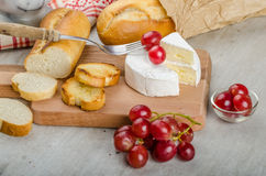 Fresh camembert from organic farms. With red grapes and toasted baguette Stock Photography
