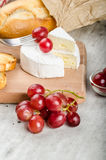 Fresh camembert from organic farms. With red grapes and toasted baguette Stock Images