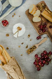Fresh camembert from organic farms. With red grapes and toasted baguette Royalty Free Stock Photo