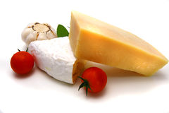 Fresh camembert and parmesan cheese chunk on dish Royalty Free Stock Images