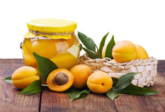 Fresh and canned peaches Stock Photo