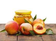 Fresh and canned peaches Stock Photography