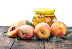 Fresh and canned peaches isolated Stock Images