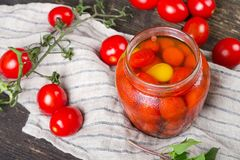 Fresh and canned tomatoes Stock Photos