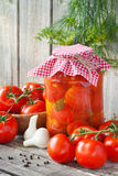 Fresh and canned tomatoes Stock Photo
