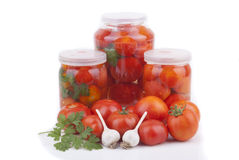 Fresh and canned tomatoes. Stock Image