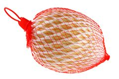 Fresh Cantaloup melon wrapped in a red plastic bag Stock Photos