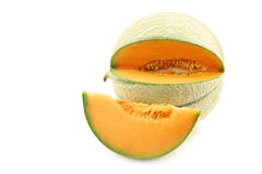 Fresh cantaloupe melon and a cut oiece Royalty Free Stock Image
