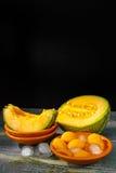 Fresh cantaloupe melon and ice, hot summer concept Stock Image