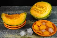 Fresh cantaloupe melon and ice, hot summer concept Royalty Free Stock Photos