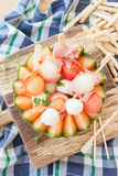 Fresh cantaloupe melon with mozzarella and ham Royalty Free Stock Images
