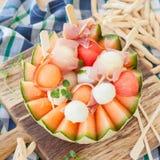 Fresh cantaloupe melon with mozzarella and ham Stock Image