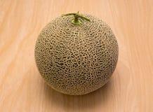 Fresh Cantaloupe melon on wood desk. Stock Photos