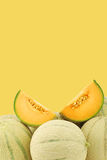 Fresh cantaloupe melons and a cut one Stock Photos