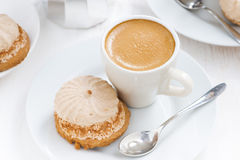 Fresh cappuccino and cakes on white table, top view Royalty Free Stock Photography