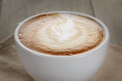 Fresh cappuccino cup with simple latte art Royalty Free Stock Images