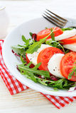 Fresh Caprese salad with arugula Royalty Free Stock Photography