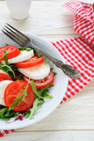 Fresh caprese salad in white plate. Fresh caprese salad, food closeup Stock Images