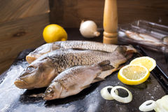 Fresh carp fish with spices and lemon. Fresh carp fish with lemon and spices Stock Photos