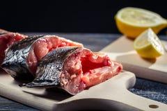 Fresh carp flavored lemon and salt Stock Photography