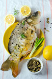 Fresh carp with lemon Stock Photos