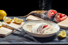 Fresh carp sprinkled with flour before frying Royalty Free Stock Photography