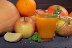 Fresh carrot, apple, pumpkin, orange, grapefruit on dark table. Stock Image