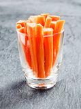 Fresh carrot batons in a glass container Royalty Free Stock Images