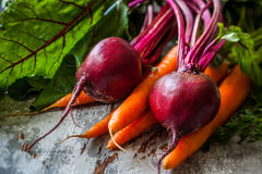Fresh carrot and beetroot. Fresh organic carrots and beetroot  on old wooden board Royalty Free Stock Photo