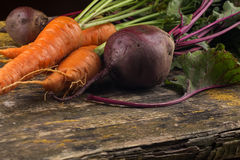 Fresh carrot and beetroot on table Royalty Free Stock Image