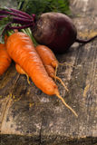 Fresh carrot and beetroot on table Stock Image