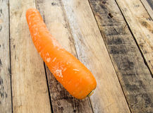 Fresh carrot bunch on grungy wooden background Stock Photo