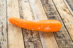 Fresh carrot bunch on grungy wooden background Royalty Free Stock Image
