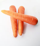 Fresh carrot isolated on a white background. 3 pieces of fresh carrot isolated on a white back ground Stock Images