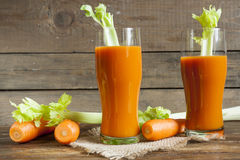 Fresh carrot juice with carrots, celery, dill and parsley Stock Photography