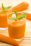 Fresh carrot juice and mint Royalty Free Stock Image